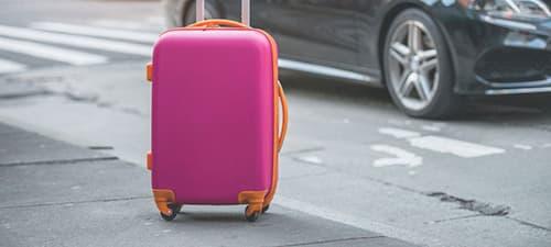 Рожева валіза